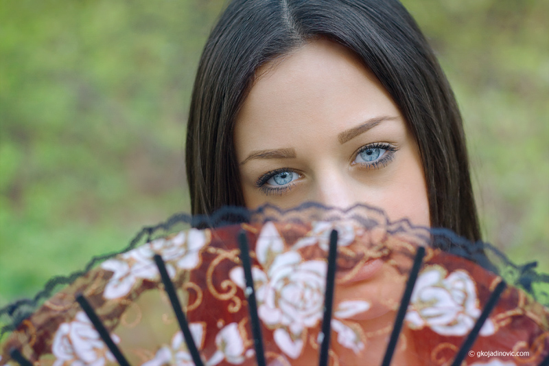 Girl with the hand fan
